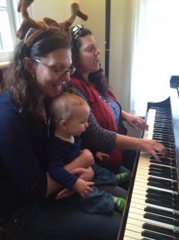Jo, Andrew and Abba singing carols