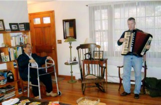 Rusty playing Len's accordion for him, Swanzey, NH