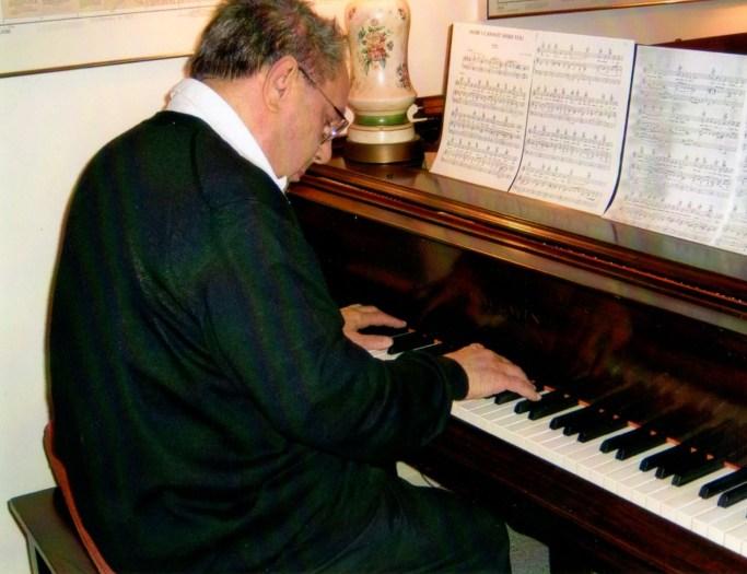 Len at his piano